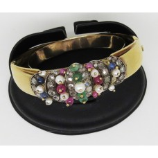 1930's 18ct bangle with Multi coloured gem