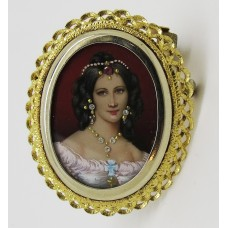 1960's brooch pendant set on 18ct gold.  In the centre a hand painted lady on ivory