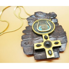 1970's Torquise Onyx Agete hand made necklace on brass and silver placed on a piece of crocodile skin